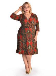 The Donna Dress is a classic and flattering wrap dress design paired with an exotic paisley print and matching empire fabric belt. The three quarter length dress hits just below the knee. The Donna Dress is perfect for any plus size woman, because it's so versatile. Wear the Donna to work with a black blazer and flats, or slip off the blazer and throw on some heels for cocktails with your friends.