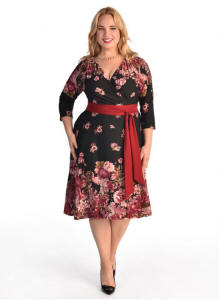 The Donna Dress is a classic and flattering wrap dress design with a red contrast fabric belt. The three quarter length dress hits just below the knee. The Donna Dress is perfect for any plus size woman, because it's so versatile. Wear the Donna to work with a black blazer and flats, or slip off the blazer and throw on some heels for cocktails with your friends.